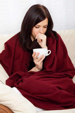 Shutterstock Nr. 95119549 | ProStockStudio Ill woman covered with blanket